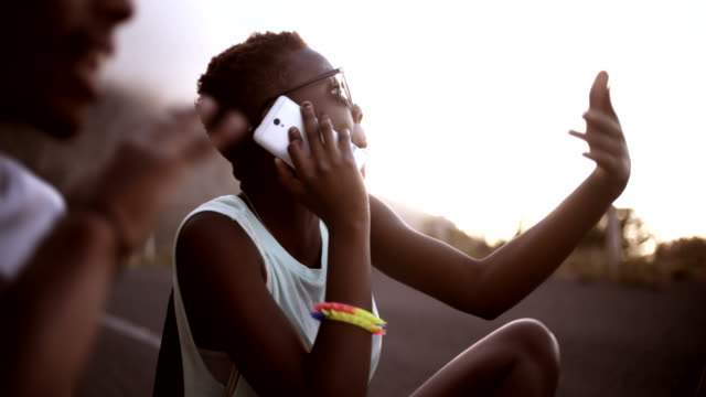 African American girl on phone with a group of friends video