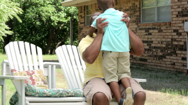 african american little boy running to his dad. - fathers day stock videos and b-roll footage