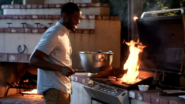 African American Male Grilling at a Summer BBQ video