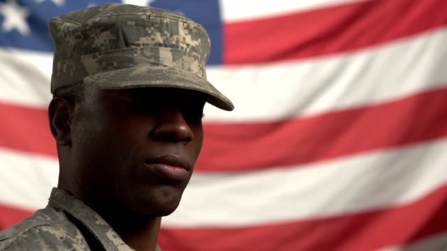 African American Male soldier, in front of US flag video