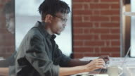 istock African American Male Worker Typing on Laptop in Loft Office 1215236426
