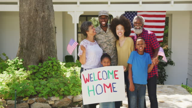 African American man coming back home with his family