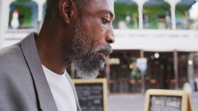 African American man eating in a coffee