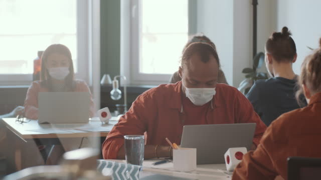 African American Man in Face Mask Working in Open Space Office