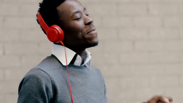 African american man listen music with headphones video