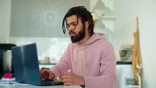 African american man networking with laptop