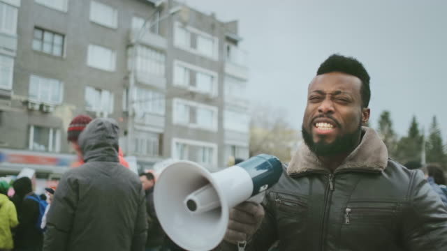 African American man scream at politics demonstration. Angry black afro people. video