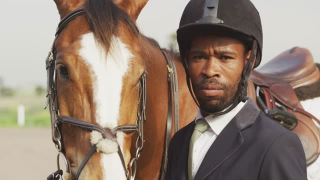 African American man with his Dressage horse