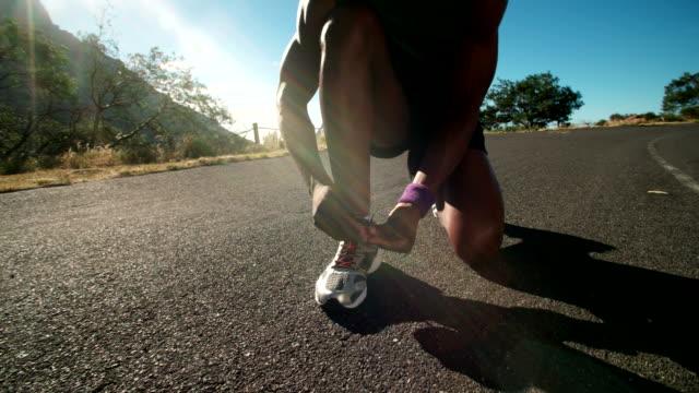African American runner tying his shoelaces video
