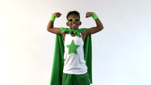 African American Super Hero in Green Cape Smiles Shot in Moreno Valley, California in July of 2015. cape garment stock videos & royalty-free footage