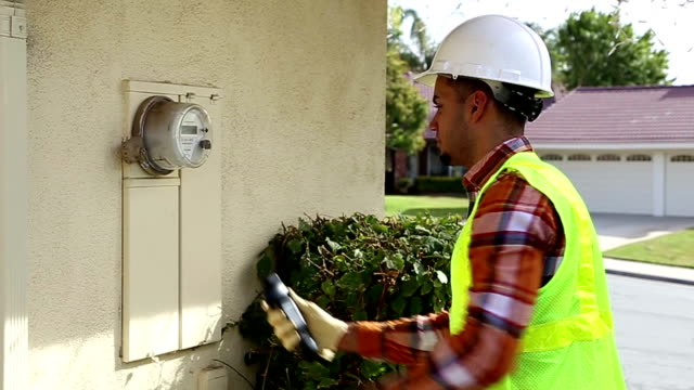 African American Utility Worker Installs Smart Meter and Smiles video