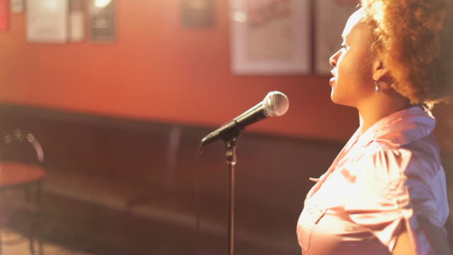 African American woman doing comedy on stage video