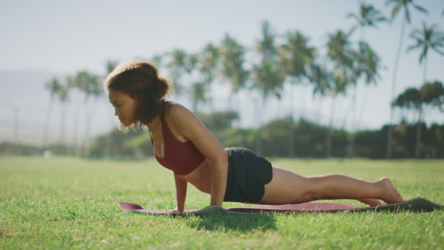 African american woman doing her morning yoga video