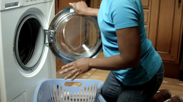 HD: African American Woman Starting a Laundry Load video