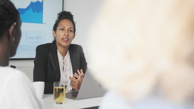 African and Hispanic Businesswomen Conversing During Meeting video