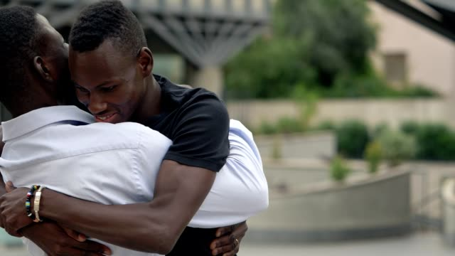 African Black Men Greeting And Hugging In The Street Slow Motion Stock  Video - Download Video Clip Now - iStock