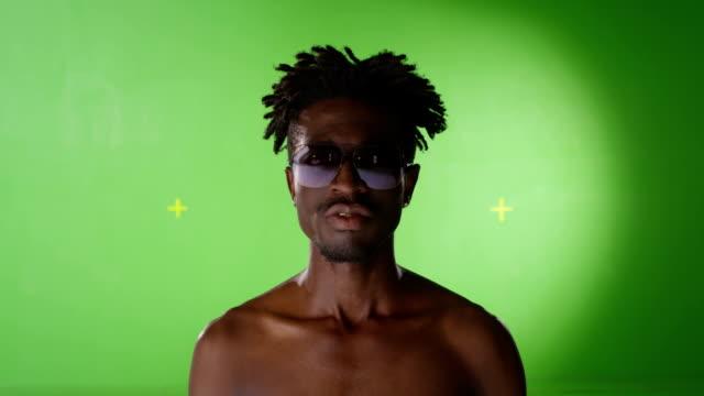 HD African black stylish man. Gold teeth. Grills, grillz. RAP style. On green screen. Few shots. video
