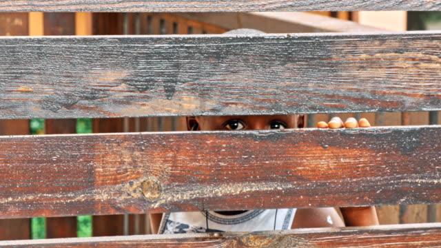 african boy refugee after fence - голодный стоковые видео и кадры b-roll