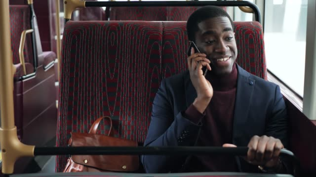 African business person commuting and using mobile phone