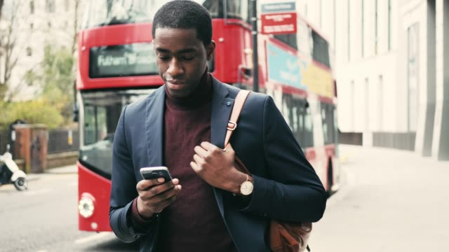 African business person commuting in London, UK