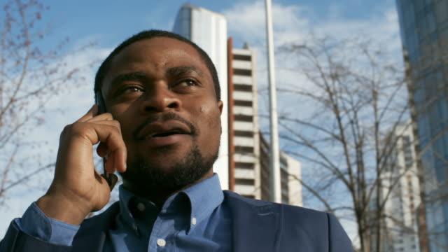 african businessman making call - call center стоковые видео и кадры b-roll