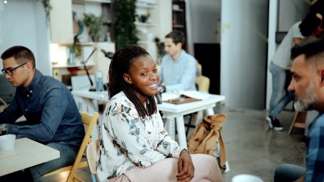 African businesswoman talking with senior advisor