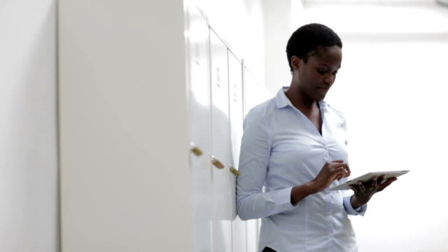 HD: African Businesswoman using digital tablet in office. video