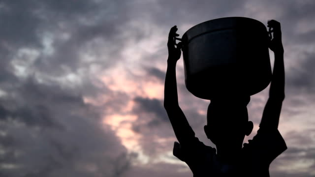African Child with Bucket on Head. Central Region, Ghana. video