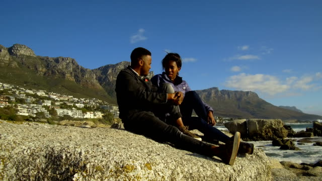 African couple at Camps Bay, South Africa Love and connection in a meaningful relationship cape town stock videos & royalty-free footage