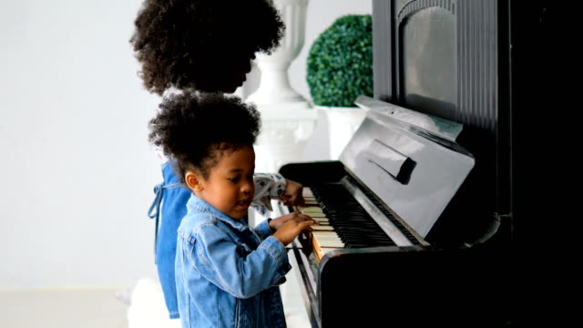 African girl playing piano