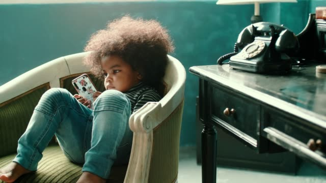 African Little Girl Playing Smart Phone