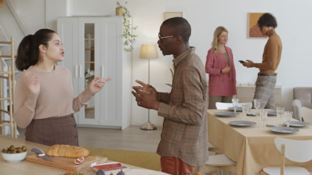 African Man and Mixed-race Woman Talking before Dinner