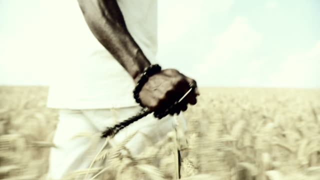HD SLOW-MOTION: African Man Blessing In Wheat video