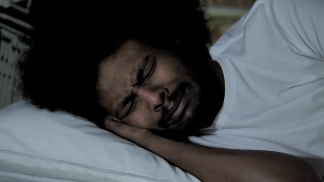 African Man Crying In Bed At Night Stock Video - Download Video Clip Now -  iStock