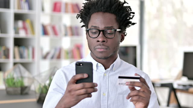 African Man having Online Payment Failure on Smartphone