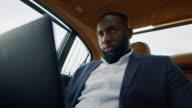istock African man looking laptop screen. Businessman working computer at car 1219046370