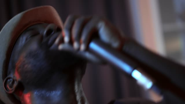 African man singing with the microphone. Close up