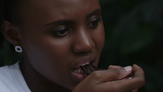 African women eating steak with fork