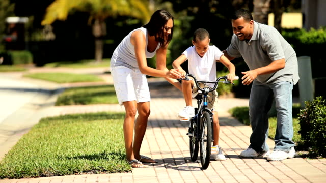 African-American Boy Learning to Ride video