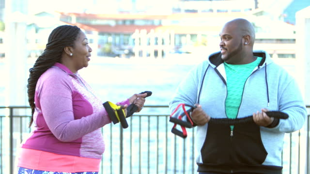 African-American couple exercising with resistance bands video
