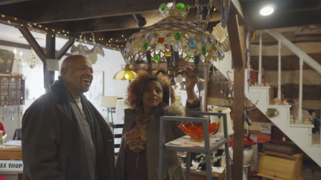 African-American Couple Shop at Antique Store