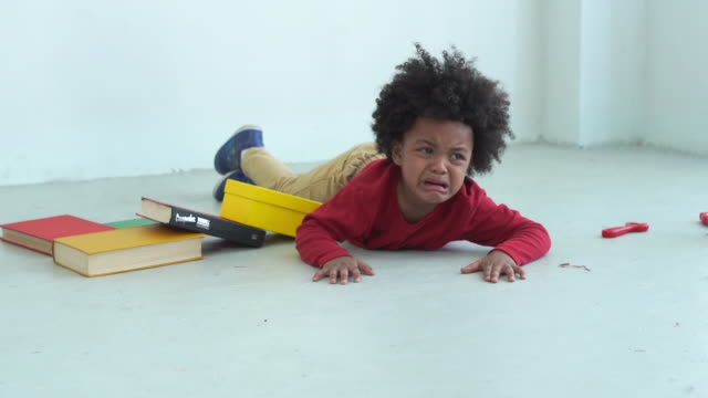 african-american ethnicity little boy , cry , sadness - scolaro video stock e b–roll