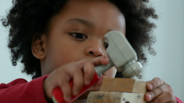 African-American Ethnicity little boy playing toy block