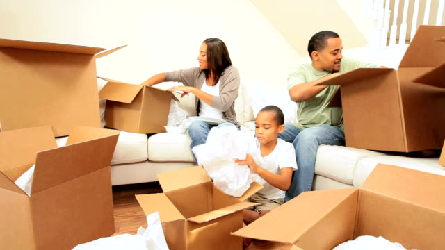 African-American Family Unpacking in New Home video
