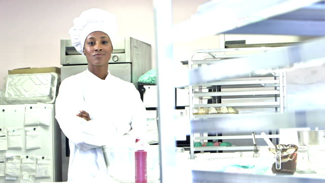 African-American female chef in commercial kitchen video