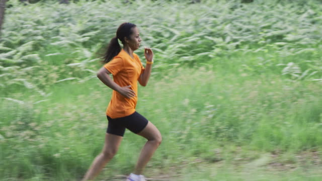 SLO MO DS African-American female running in forest video