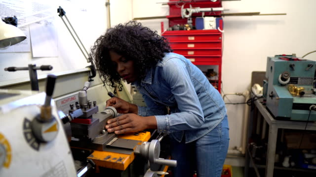 African-American female worker in engineering workshop African-American female worker in engineering workshop manufacturing occupation stock videos & royalty-free footage