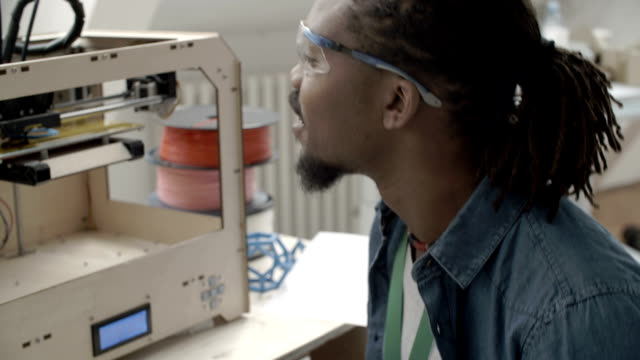 HD: African-american Man Working By 3D Printer. video
