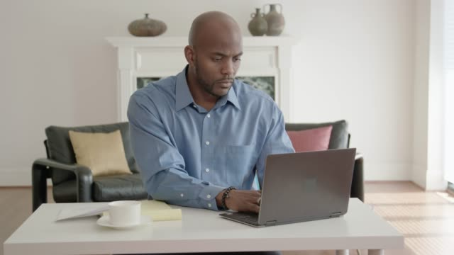 African-American Man Working from Home Office video