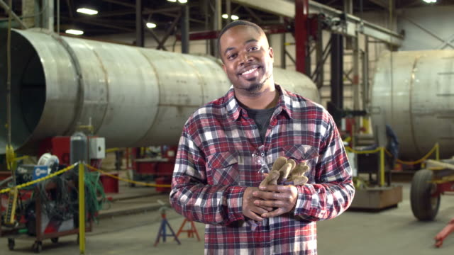 African-American man working in metal fabrication shop